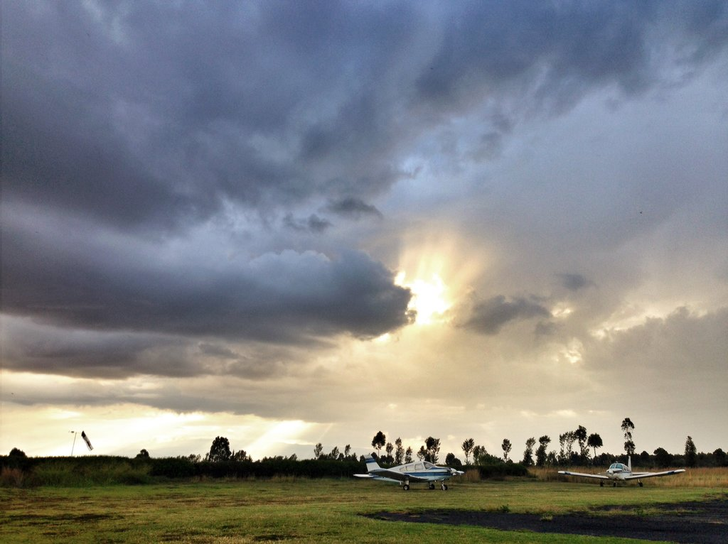 After a downpour, sun rays over the Nanyuki airfield at Barnies
