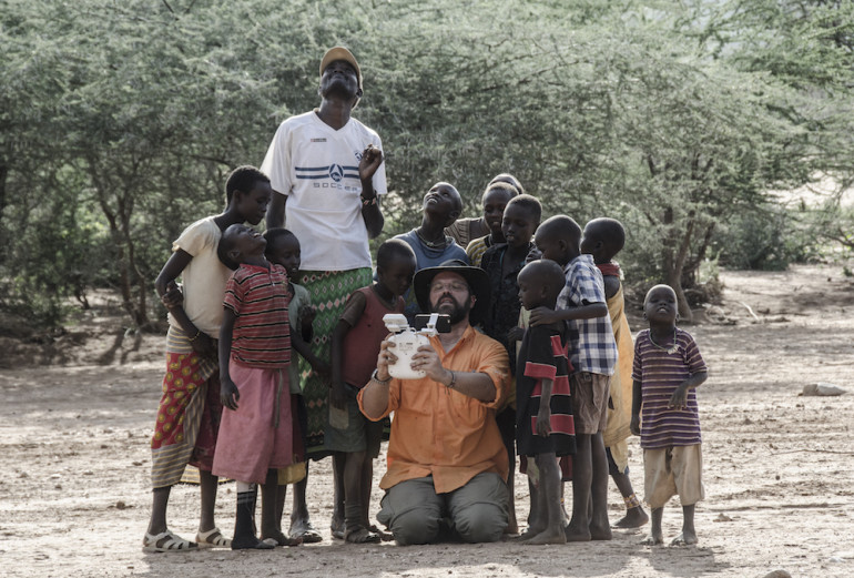 Tall Mike and myself with the village kids