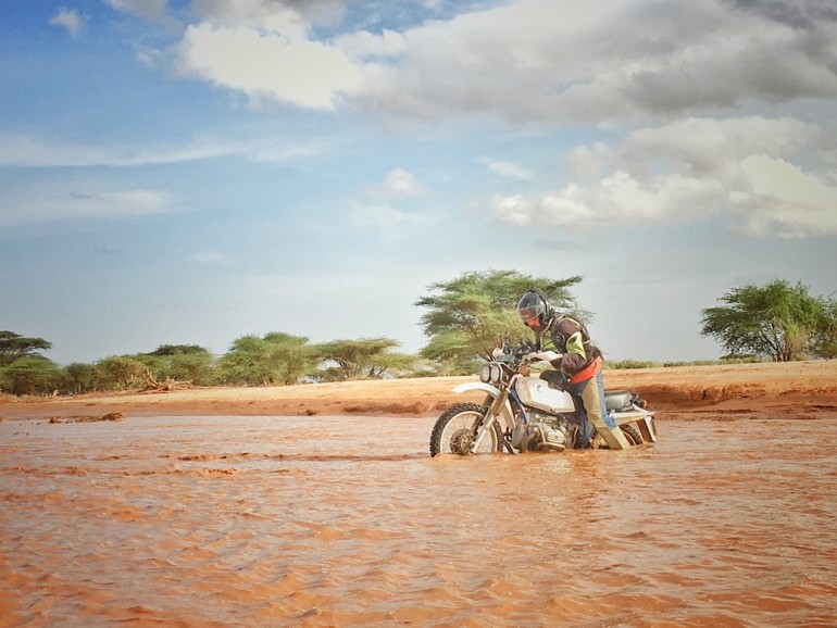 Philip fords a sand river in an old BMW R80G/S