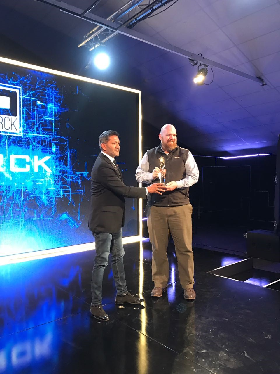 CEO Erik Hersman accepting award at AfricaCom