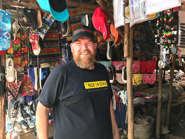 Erik in a shoe market